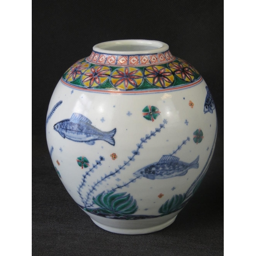 499 - An Oriental fish vase with geometric decoration upon. 20cm high....
