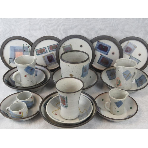 506 - A quantity of contemporary stoneware studio pottery table items including dinner plated, bowls, vase...