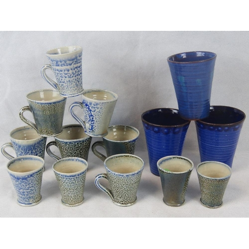 514 - A quantity of fourteen assorted studio pottery mugs and cups. Unmarked. Various sizes....