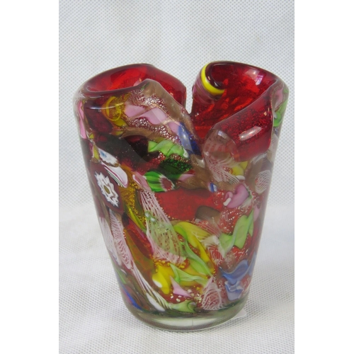 601 - A heavy multi-coloured overlaid Italian Murano glass vase standing 13.5cm high....