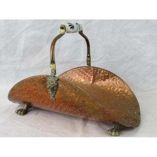 606 - A hammered copper fire side log basket with brass ceramic handle. AF...
