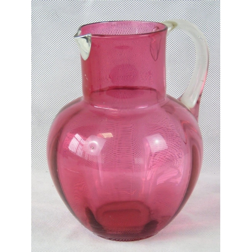 619 - A large cranberry jug with white metal spout standing  20cm high....