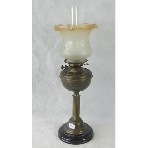 652 - A Victorian oil lamp with glass chimney and acid-etched fluted shade all standing 66cm high....