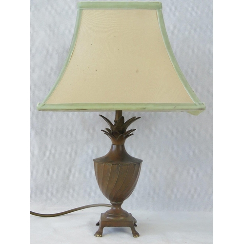 663 - A good brass-base table lamp of Classical form raises over four feet and complete with shade. Recent...