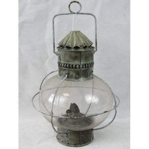 684 - A vintage glazed storm oil lamp in original condition throughout....