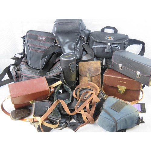 834 - A large quantity of retro and vintage leather, leatherette and canvas camera cases....