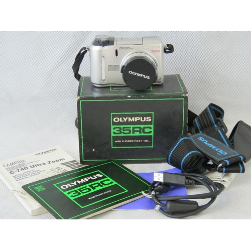 835 - An Olympus Camedia C-740 Ultra Zoom camera with carry strap, USB cable and original instructions. Wi...