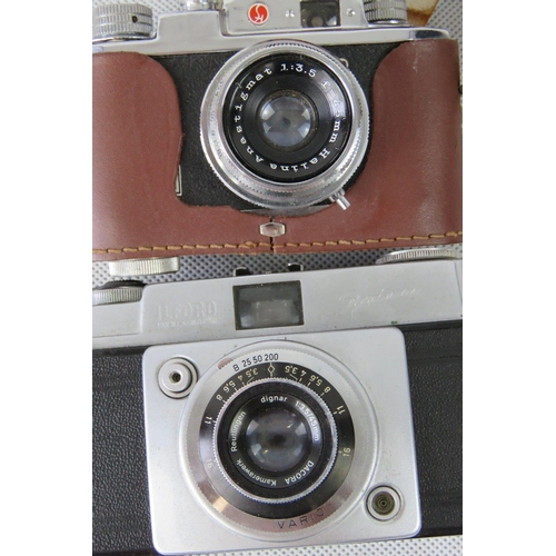 840 - A vintage Ilford Sportsman camera with Vario 1:3,5 45mm lense and pig skin leather case together wit...
