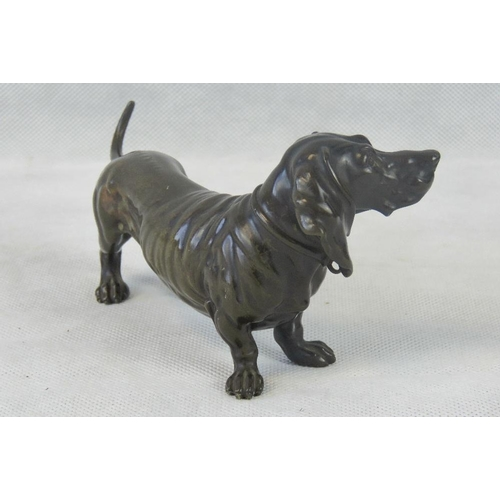 1 - A contemporary bronzed Basset Hound, unmarked and measuring 19cm in length....