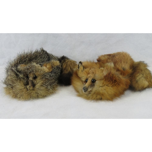 14 - Two fox fur hats....
