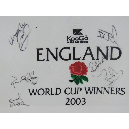 65 - A signed England rugby World Cup winners 2003 t-shirt; signed by Matt Dawson; Steve Thompson, Paul G...