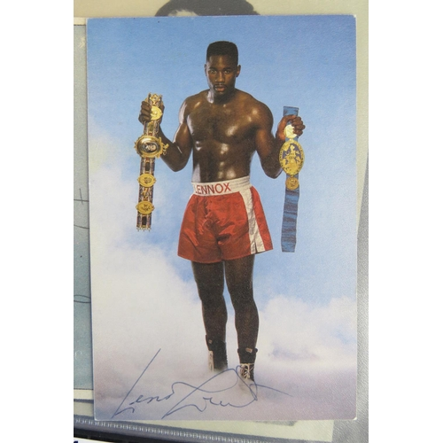 28 - A collection of Boxing autographs including Chris Eubank and Lennox Lewis also some boxer publicity ...