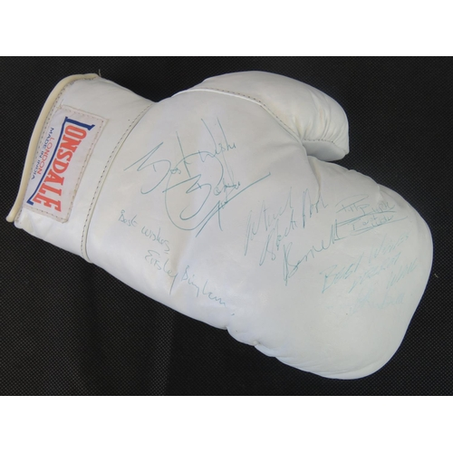 74 - A signed white Lonsdale boxing glove; signed by H.Graham, Pat Barrett, T.E. Kubia, Elesley Bingham, ...