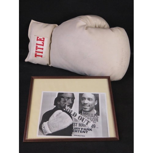 76 - A large white Title boxing glove signed by Barry McGuigan, Nigel Benn, Michael Watson; Lloyd Honeygh...