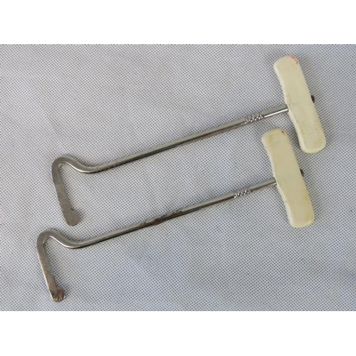 111 - A pair Ivorine-handled boot pulls....