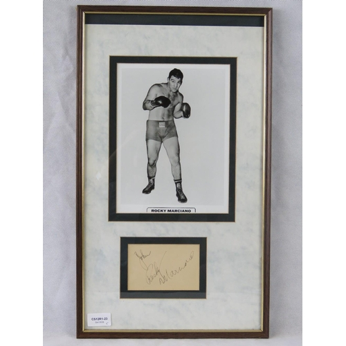25 - A photographic print of the boxer Rocky Marciano with a separate autograph below, mounted and framed...