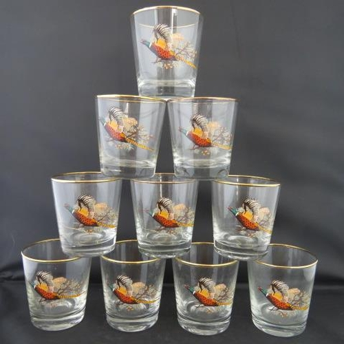 34 - A set of 10 gilded pheasant-themed whisky tumblers....