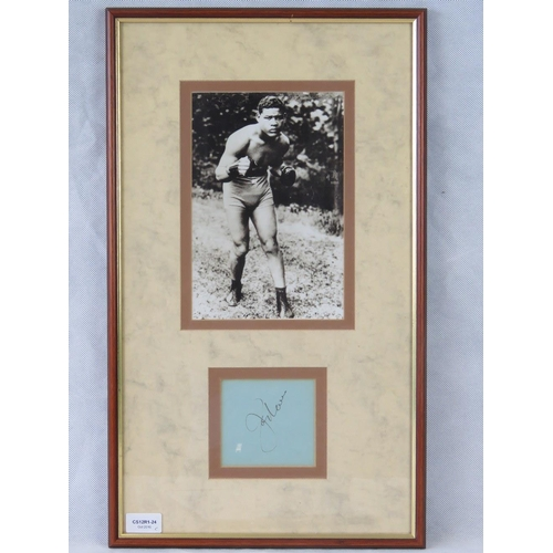 86 - A photographic print of the boxer Joe Louis with a separate autograph, mounted and framed; sight siz...