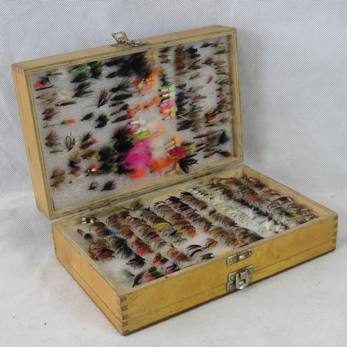 115 - A three- tier 'Bob Church & Co' fly box containing around 1000 flies as tied and uses by Bob Church ...