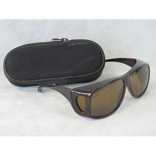 94 - A pair of Cocoon Polaroid fishermans sunglasses in original case. As new. From the personal collecti...
