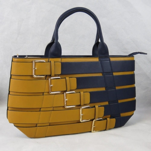 102 - Handbag. Yellow and navy buckle design, two handles, zip closure, to internal zip pockets and two in...
