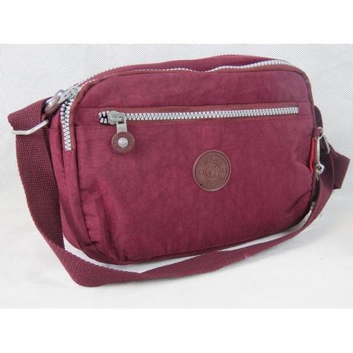 105 - Handbag. Burgundy, single handle, two zip closing compartments, internal zip pocket, zip pocket with...