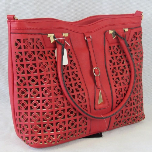 109 - Tote bag and removable matching handbag. Red, pierce detailing to front, two handles, zip closure, i...