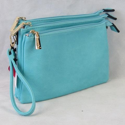 115 - Clutch bag. Turquoise, three zip closure compartments, one internal zip pocket and two internal open...