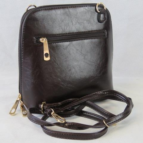 121 - Handbag. Brown, shoulder strap, zip closure, two internal zip pockets. 22cm wide....
