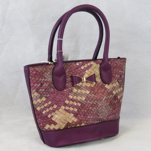128 - Handbag. Purple woven design, bow detail, two handles, zip closure, internal zip pocket and two inte...