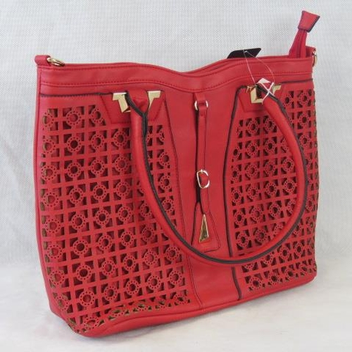 131 - Tote bag and removable matching handbag. Red, pierce detailing to front, two handles, zip closure, i...