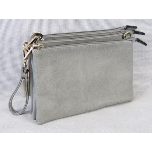 143 - Clutch bag. Grey, three zip closure compartments, one internal zip pocket and two internal open pock...