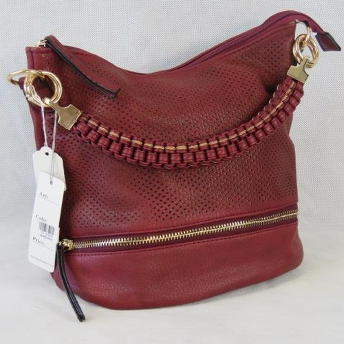 154 - Handbag. Red with piercing and zip detail, single braided handle, zip closure, two internal zip pock...