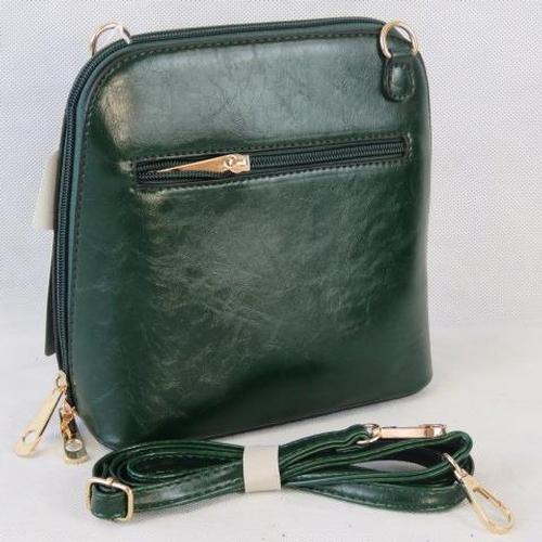 159 - Handbag. Dark green, shoulder strap, zip closure, two internal zip pockets. 22cm wide....