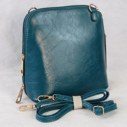 161 - Handbag. Sea green, shoulder strap, zip closure, two internal zip pockets. 22cm wide....