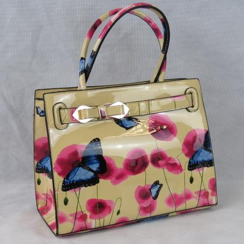 183 - Handbag, Cream ground with pink/poppy and blue butterfly design, bow detail, two handles, zip closur...