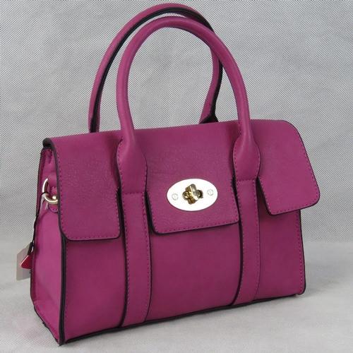 19 - Handbag. Pink, two handles, clasp and zip closure, internal zip pocket and two internal open pockets...