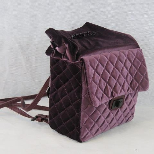 191 - Backpack. Purple velvet with black chain detail, drawstring and zip fastening, adjustable straps, in...