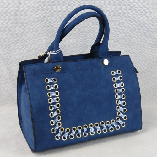 196 - Handbag. Navy with pierced detail to front, two handles, zip closure, three internal zip pockets and...