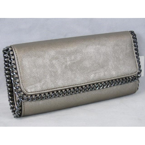 197 - Clutch bag. Silver with black chain detail, double popper closure, two compartments, internal zip po...
