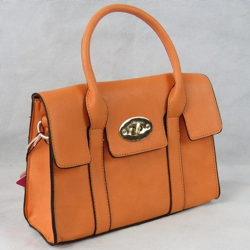 20 - Handbag. Orange, two handles, clasp and zip closure, internal zip pocket and two internal open pocke...