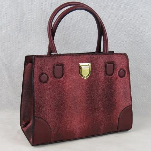 203 - Handbag. Metallic burgundy, two handles, zip closure, two internal zip pockets and two internal open...