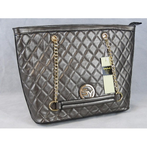205 - Handbag. Metallic grey, two chain handles, zip closure, one internal zip pocket and two internal ope...