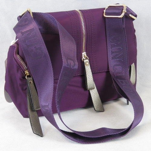 209 - Handbag. Purple, shoulder strap, popper and zip closure, internal zip pocket, zip pocket on either s...