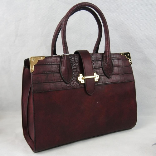 22 - Handbag. Burgundy with crocodile effect border to top, two handles, strap and zip closure, two inter...