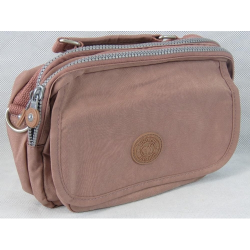 24 - Handbag. Dusky pink, single handle, two zip closing compartments, internal zip pocket, zip pocket wi...