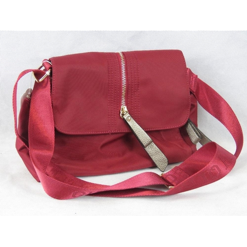 247 - Handbag. Red, shoulder strap, popper and zip closure, internal zip pocket, zip pocket on either side...