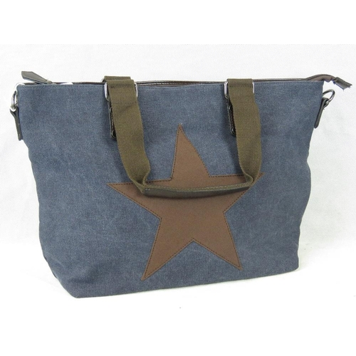 249 - Tote bag. Navy canvas with brown straps and star detail, two handles, zip closure, internal zip pock...