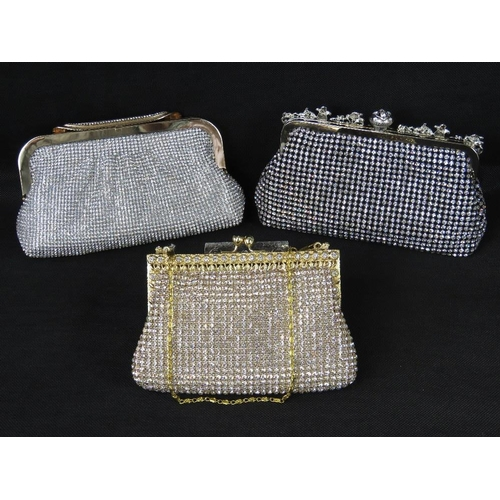 253 - Evening bags. Three evening bags encrusted with white stones, each with clasp closure, internal open...