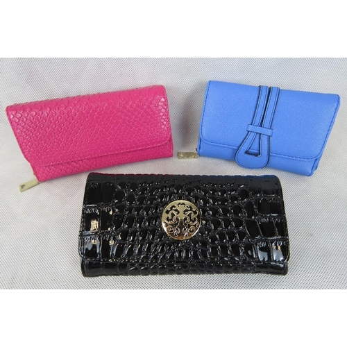 260 - Purses. Two purses; Pink python effect, and black patent crocodile effect. Popper closure, two compa...